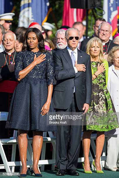 First Lady Michele Obama Vice President Joe Biden and his wife Jill Biden sing the National Anthem during an arrival ceremony on the South Lawn of...