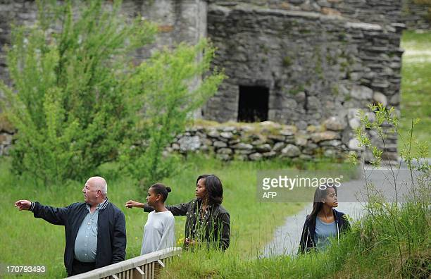 First Lady Michelle Obama, accompanied by her two daughters, Sasha and Malia , visits Glendalough with tour guide George McClafferty , in the Wicklow...