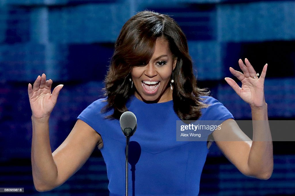 First lady Michelle Obama acknowledges the crowd before delivering remarks on the first day of the Democratic National Convention at the Wells Fargo Center, July 25, 2016 in Philadelphia, Pennsylvania. An estimated 50,000 people are expected in Philadelphia, including hundreds of protesters and members of the media. The four-day Democratic National Convention kicked off July 25.