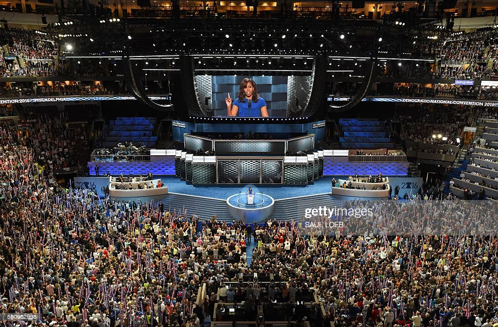 US First Lady Michelle Obama addresses delegates on Day 1 of the National Convention at the Wells Fargo Center in Philadelphia, Pennsylvania, July 25, 2016. / AFP / Saul LOEB