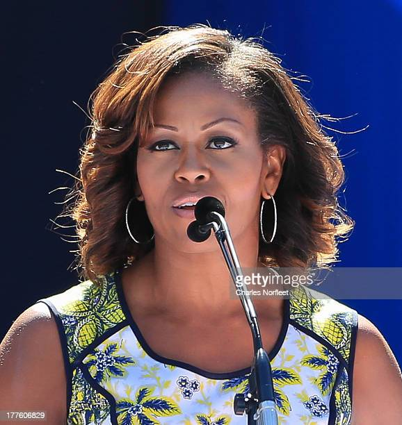 First Lady Michelle Obama addresses the crowd during the 2013 Arthur Ashe Kids Day at USTA Billie Jean King National Tennis Center on August 24 2013...