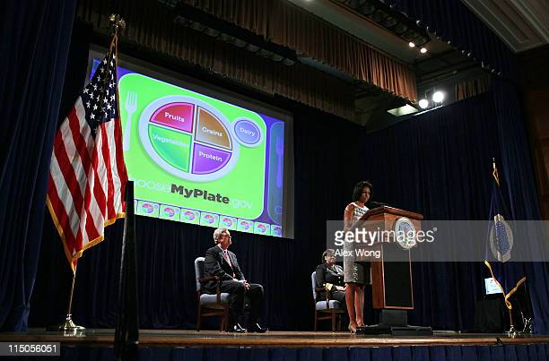 S first lady Michelle Obama Agriculture Secretary Tom Vilsack and Surgeon General Regina Benjamin unveil a new food icon during an event June 2 2011...