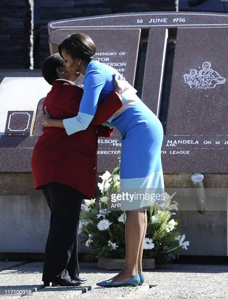 US First Lady Michelle Obama and Antoinette Sithole the sister of Hector Pieterson a 12yearold boy killed during the student uprising in protest at...