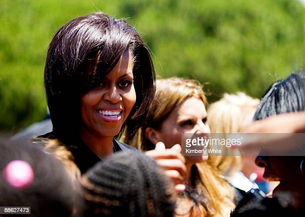 First Lady Michelle Obama and California First Lady Maria Shriver greet children after helping build a play ground at the Bret Harte Elementary...