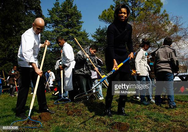 S first lady Michelle Obama and Chef Sam Kass take part in the groundbreaking of the White House Kitchen Garden on the South Lawn of the White House...