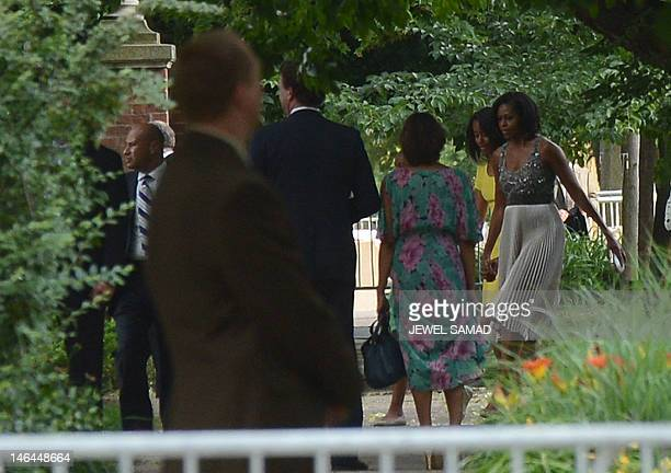 First Lady Michelle Obama and daughters Malia and Sasha walk to Valerie Jarrett's house to attend her daughter Laura Jarret's wedding in Chicago...