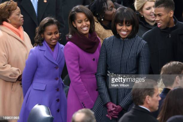 First lady Michelle Obama and daughters Sasha Obama and Malia Obama arrive during the presidential inauguration on the West Front of the US Capitol...