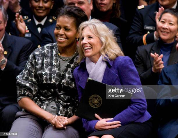 First lady Michelle Obama and Doctor Jill Biden wife of US Vice President Joe Biden laugh as a Alma Powell speaks during the ServiceNation launch of...