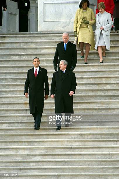 First lady Michelle Obama and first lady Laura Bush in back are lead out of the Capitol by President Barack Obama and former President George W Bush...