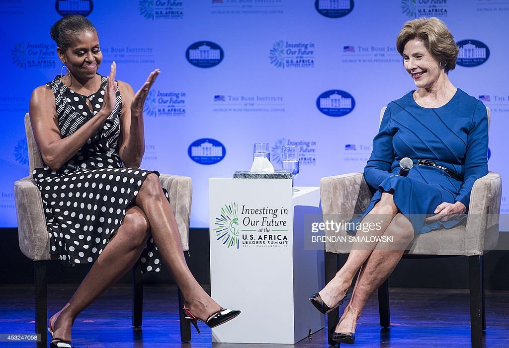 US First Lady Michelle Obama (L) and former First Lady Laura Bush host 'Investing in Our Future' at the US - Africa Leaders Summit at the Kennedy Center August 6, 2014 in Washington, DC. The day-long symposium will bring together First Lady Michelle Obama, Mrs. Laura Bush, African first spouses from nearly 30 countries, leaders from non-governmental and non-profit organizations, private sector partners, and other leading experts.The symposium will highlight the important role first spouses play and will focus on the impact of investments in education, health, and economic development through public-private partnerships. AFP PHOTO/Brendan SMIALOWSKI