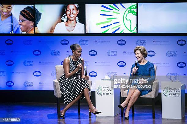 US first lady Michelle Obama and former US first lady Laura Bush during a panel discussion during Investing in Our Future at the USAfrica Leaders...