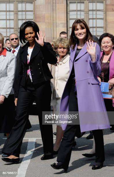 First Lady Michelle Obama and French First Lady Carla BruniSarkozy wave as they leave the Cathedral of Strasbourg on April 4 2009 in Strasbourg France