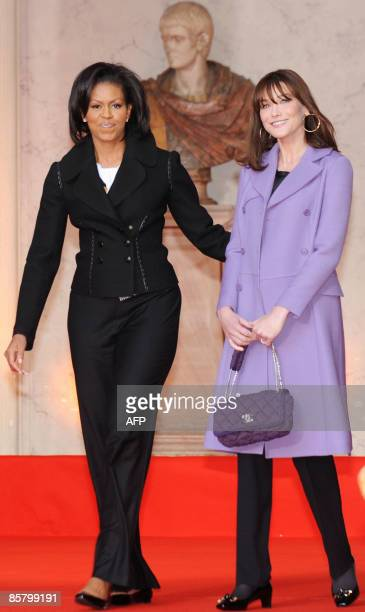 First Lady Michelle Obama and French First Lady Carla Bruni-Sarkozy pose for photographers as they visit a museum in Strasbourg, eastern France on...