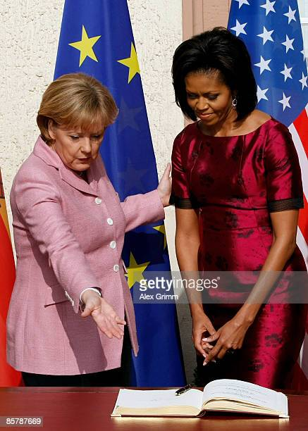 First Lady Michelle Obama and German Chancellor Angela Merkel sign the Golden Book of the city of Baden Baden upon U.S: President Barack Obama's...