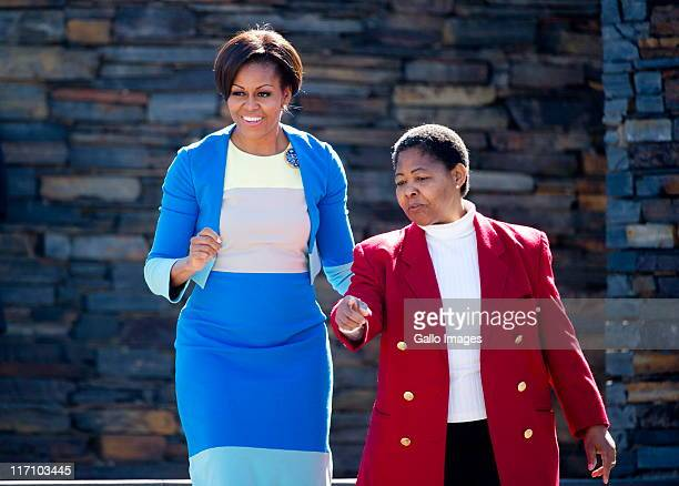 US First Lady Michelle Obama and Hector Pieterson's sister Antoinette Sithole at the Hector Pieterson memorial site on June 22 2011 in Soweto...