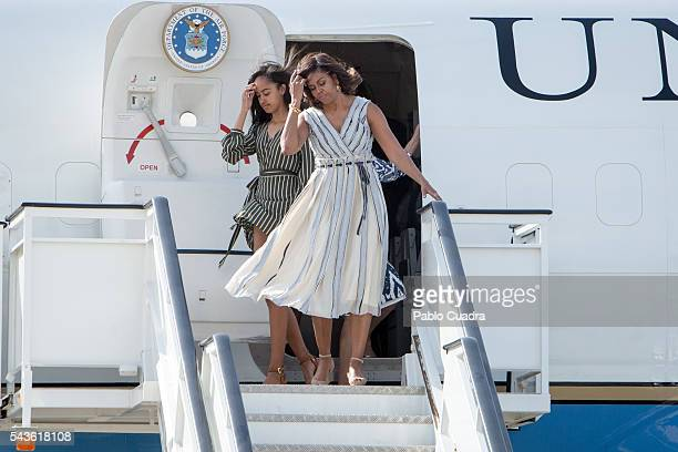 First Lady Michelle Obama and her daughter Malia Obama arrive at Torrejon Air Force Base on June 29 2016 in Madrid The First Lady will deliver a...