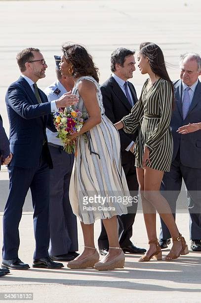 First Lady Michelle Obama and her daughter Malia Obama arrive at Torrejon Air Force Base on June 29, 2016 in Madrid. The First Lady will deliver a...