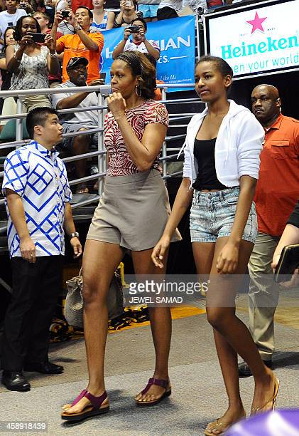 US First Lady Michelle Obama and her daughter Sasha arrive to watch the Oregon State University vs University of Akron college basketball game at the...