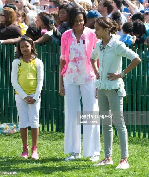 First Lady Michelle Obama and her daughters Sasha and Malia attend the annual White House Easter Egg Roll hosted by US President Barack Obama during...