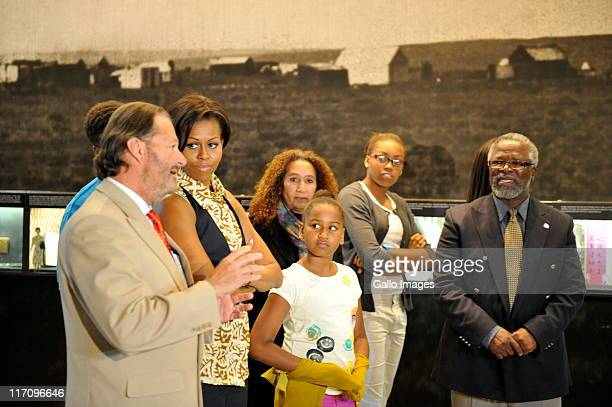 US First Lady Michelle Obama and her daughters Sasha and Malia Obama during a tour of the Apartheid Museum on June 21 2011 in Johannesburg South...