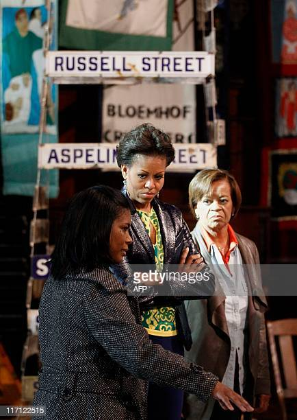 US first lady Michelle Obama and her mother Marian Robinson listens to Bonita Bennett director as they visit the District Six museum in Cape Town...