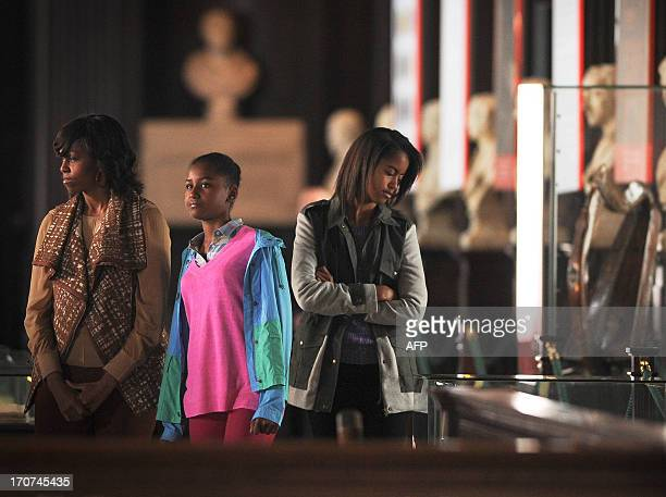 First Lady Michelle Obama and her two daughters, Sasha and Malia tour the Old Library Building at Trinity College in Dublin, Ireland, on June 17,...
