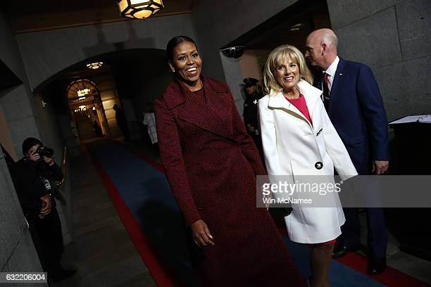 First lady Michelle Obama and Jill Biden arrive on the West Front of the US Capitol on January 20 2017 in Washington DC In today's inauguration...