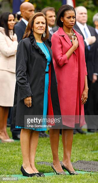 S first lady Michelle Obama and Mexican first lady Margarita Zavala listen to each countries' national anthem during a welcoming ceremony on the...