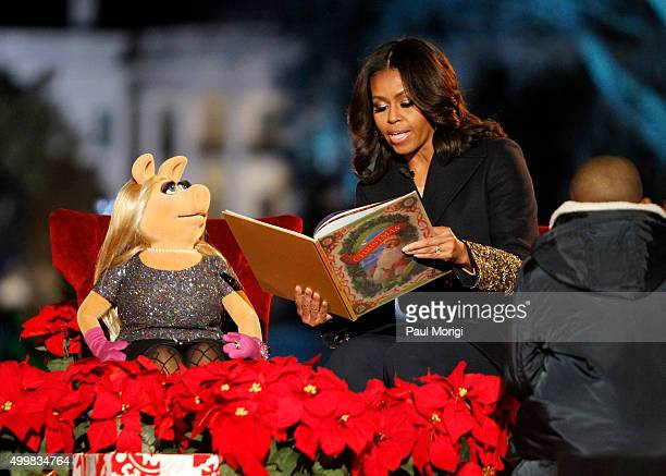 First Lady Michelle Obama and Muppet Miss Piggy read 'Twas the Night Before Christmas' to children at the 93rd Annual National Christmas Tree...