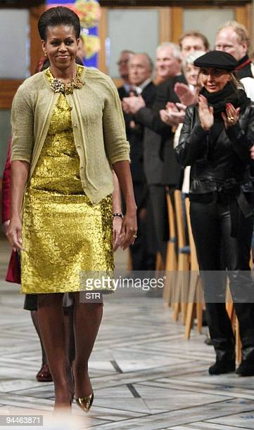 First Lady Michelle Obama and Nobel Peace Prize laureate US President Barack Obama arrive for the Nobel Peace prize award ceremony at the City Hall...