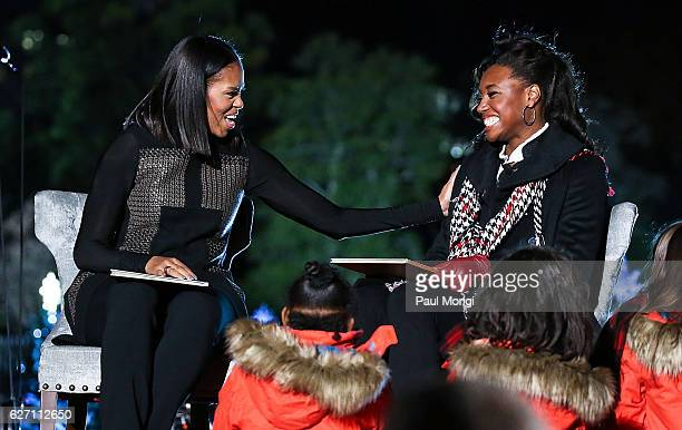 """First Lady Michelle Obama and Olympic medal winner Simone Manuel read """"Twas The Night Before Christmas"""" to children onstage during the 94th Annual..."""