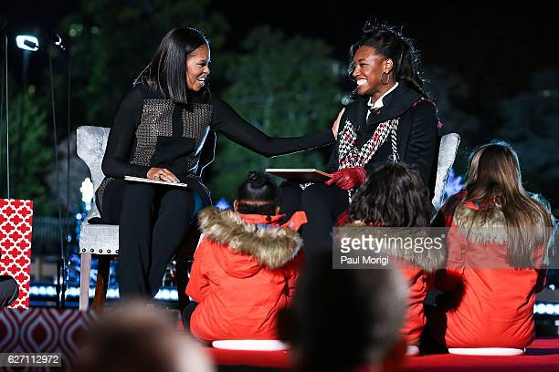 First Lady Michelle Obama and Olympic medal winner Simone Manuel read Twas The Night Before Christmas to children onstage during the 94th Annual...