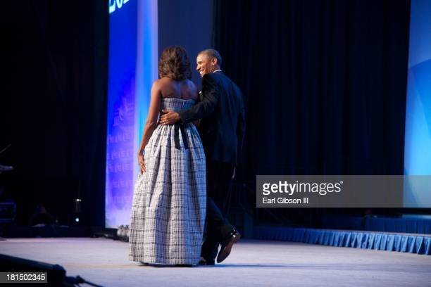 First Lady Michelle Obama and President Barack Obama leave the stage after attending the Phoenix Awards Dinner of the 43rd Annual Legislative...