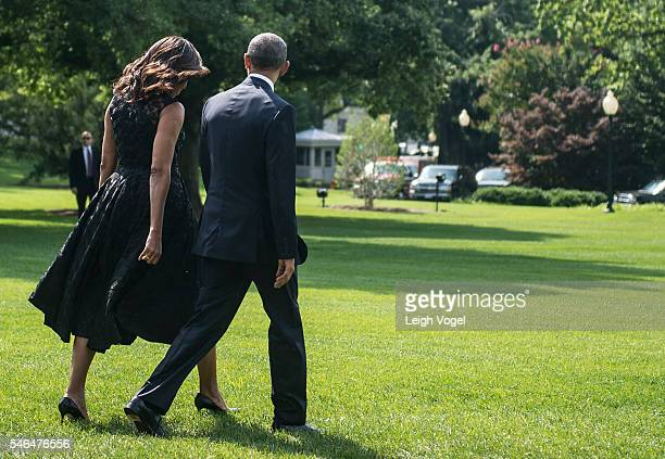 First Lady Michelle Obama and President Barack Obama leave the White House to board Marine One on July 12 2016 in Washington DC The Obamas are on...