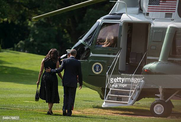 First Lady Michelle Obama and President Barack Obama leave the White House and board Marine One on July 12 2016 in Washington DC The Obamas are on...