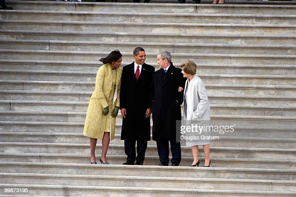 First lady Michelle Obama and President Barack Obama talk with former President George W Bush and former first lady Laura Bush after the 56th...