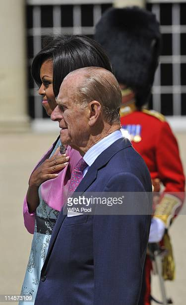 First Lady Michelle Obama and Prince Philip Duke of Edinburgh stand to listen to the US National Anthem during a ceremonial welcome in the garden of...