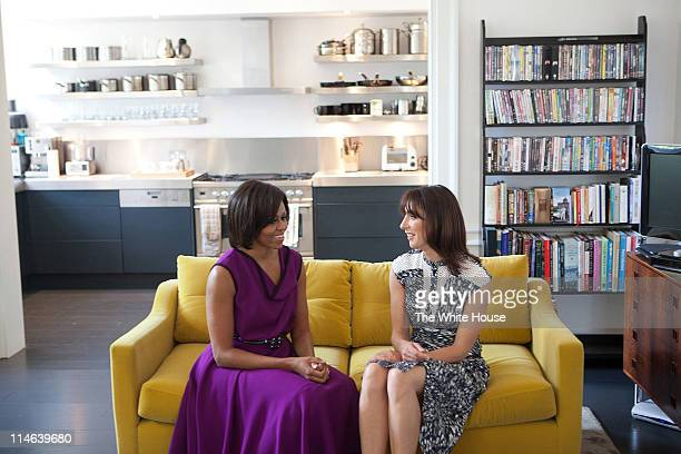 S First Lady Michelle Obama and Samantha Cameron wife of British Prime Minister David Cameron talk before having tea in the private residence at...