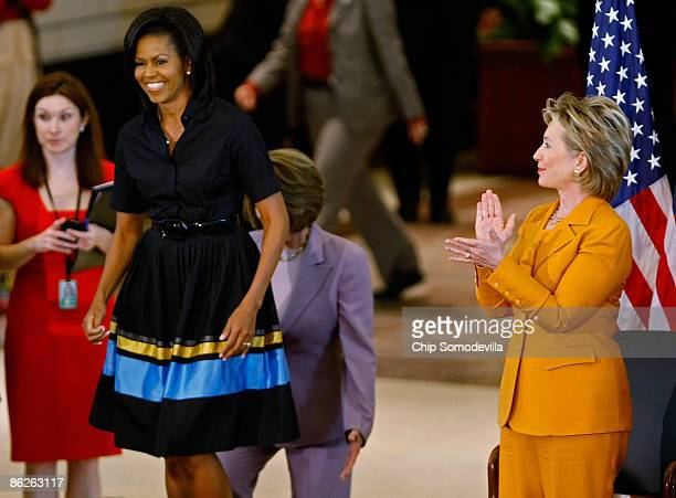 First Lady Michelle Obama and Secretary of State Hillary Clinton arrive for the unveiling ceremony for the bust of Sojourner Truth in the US Capitol...