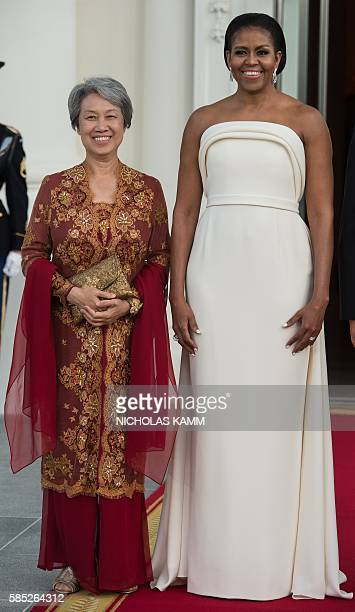 US First Lady Michelle Obama and Singapore's Ho Ching wife of Prime Minister lee Hsien Loong pose for a photo before a state dinner at the White...