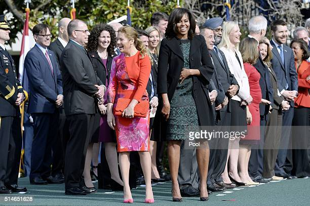 First Lady Michelle Obama and Sophie Grégoire-Trudeau share a laugh during a ceremony at the White House for an Official Visit March 10, 2016 in...