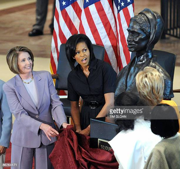 US First Lady Michelle Obama and Speaker of the House Nancy Pelosi help to unveil the bust of Sojourner Truth in Emancipation Hall of the US Capitol...