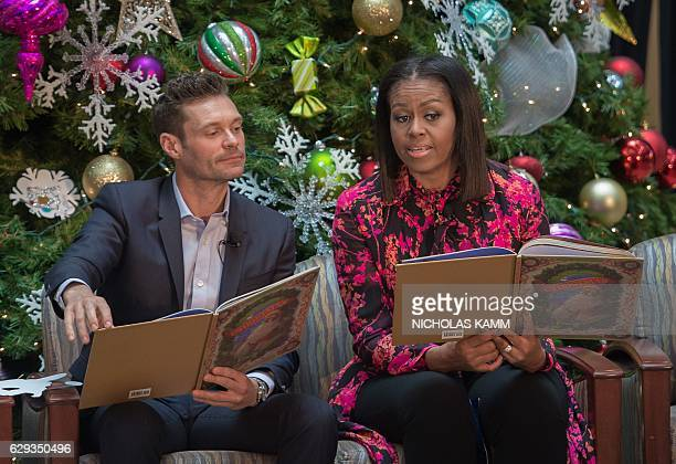US First Lady Michelle Obama and television personality Ryan Seacrest read Twas The Night Before Christmas to children at the Children's National...