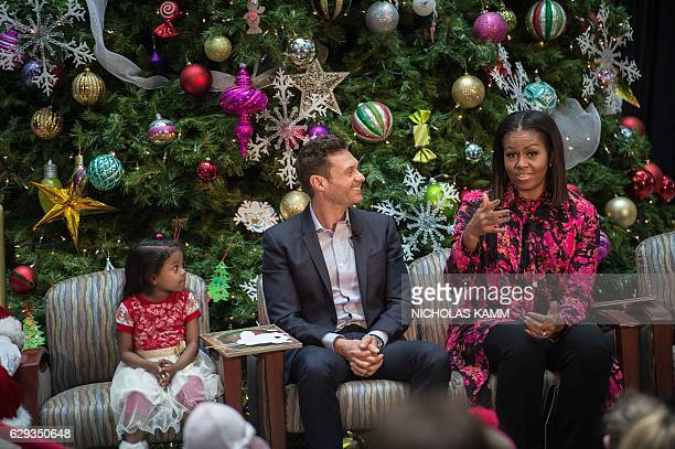 US First Lady Michelle Obama and television personality Ryan Seacrest speak after reading Twas The Night Before Christmas to children at the...