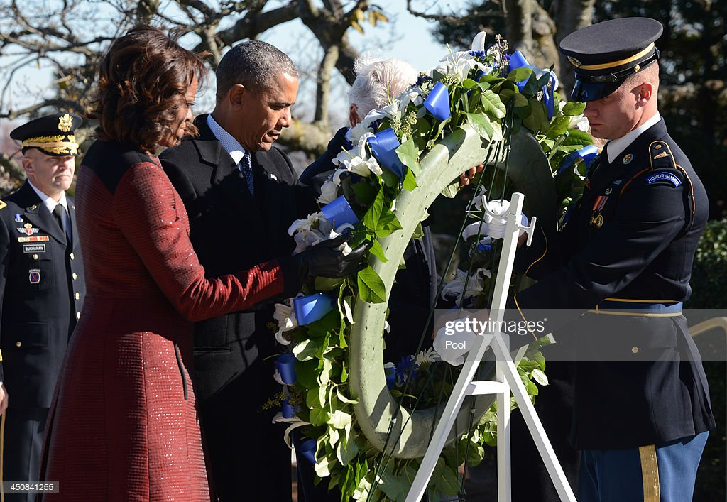 First lady Michelle Obama (2nd L) and U.S. President Barack Obama (3rd L) lay a wreath at the grave site for President John F. Kennedy at Arlington National Cemetery November 20, 2013 in Arlington, Virginia. The 50th anniversary of the assassination of John F. Kennedy will be marked on November 22.