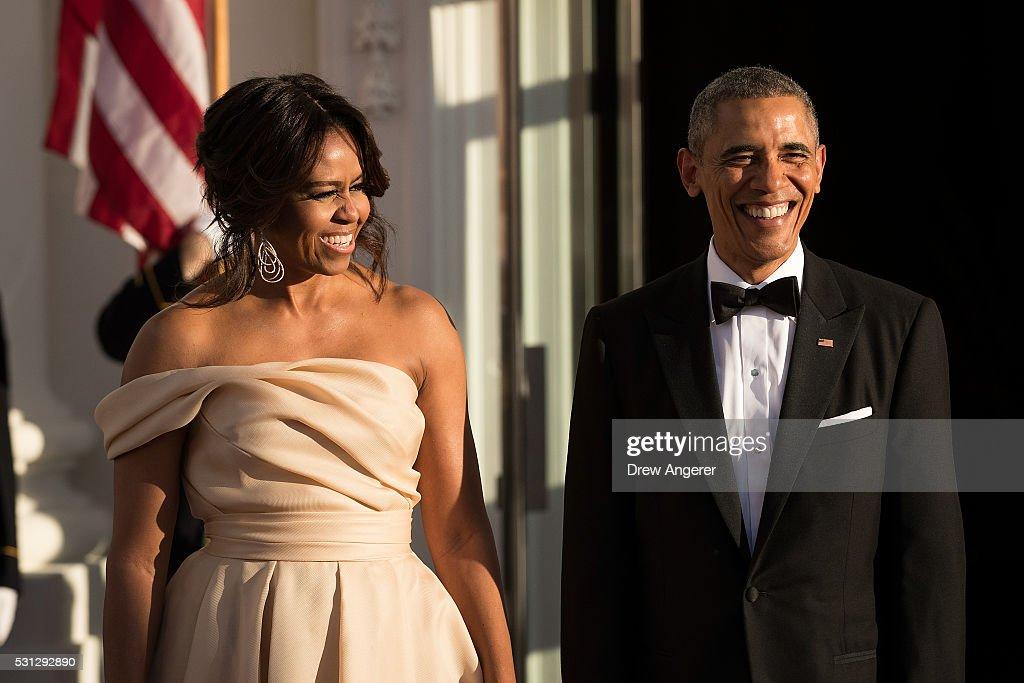 First Lady Michelle Obama and U.S. President Barack Obama ...