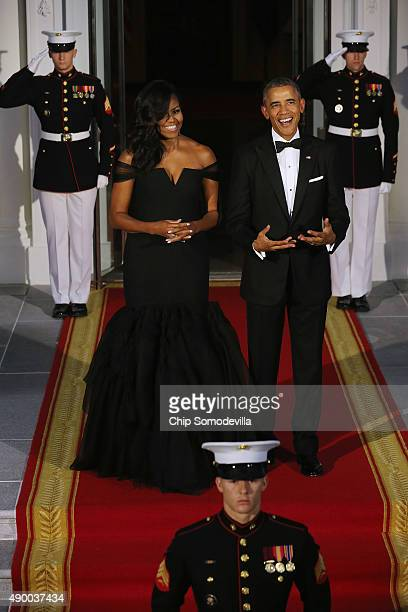 S First Lady Michelle Obama and US President Barack Obama wait on the North Portico for the arrival of Chinese President Xi Jinping and his wife...