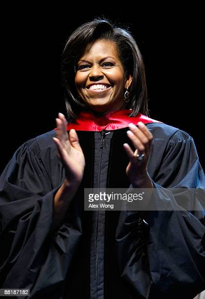 S first lady Michelle Obama applauds during the commencement for the Washington Math Science Technical High School June 3 2009 at the Cramton...