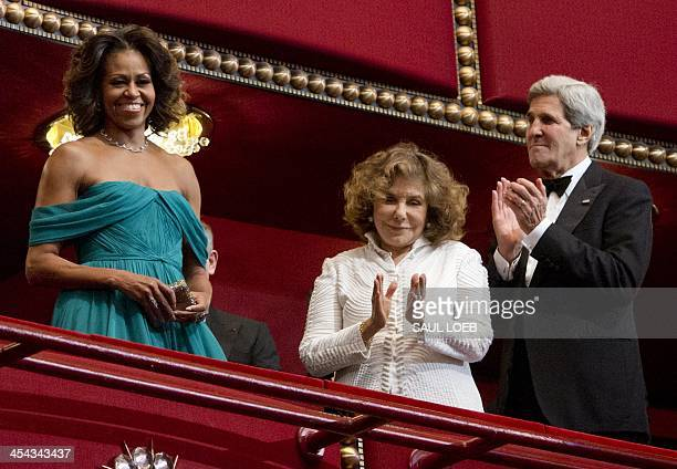 US First Lady Michelle Obama arrives alongside Secretary of State John Kerry and his wife Teresa Heinz Kerry for the 2013 Kennedy Center Honors award...