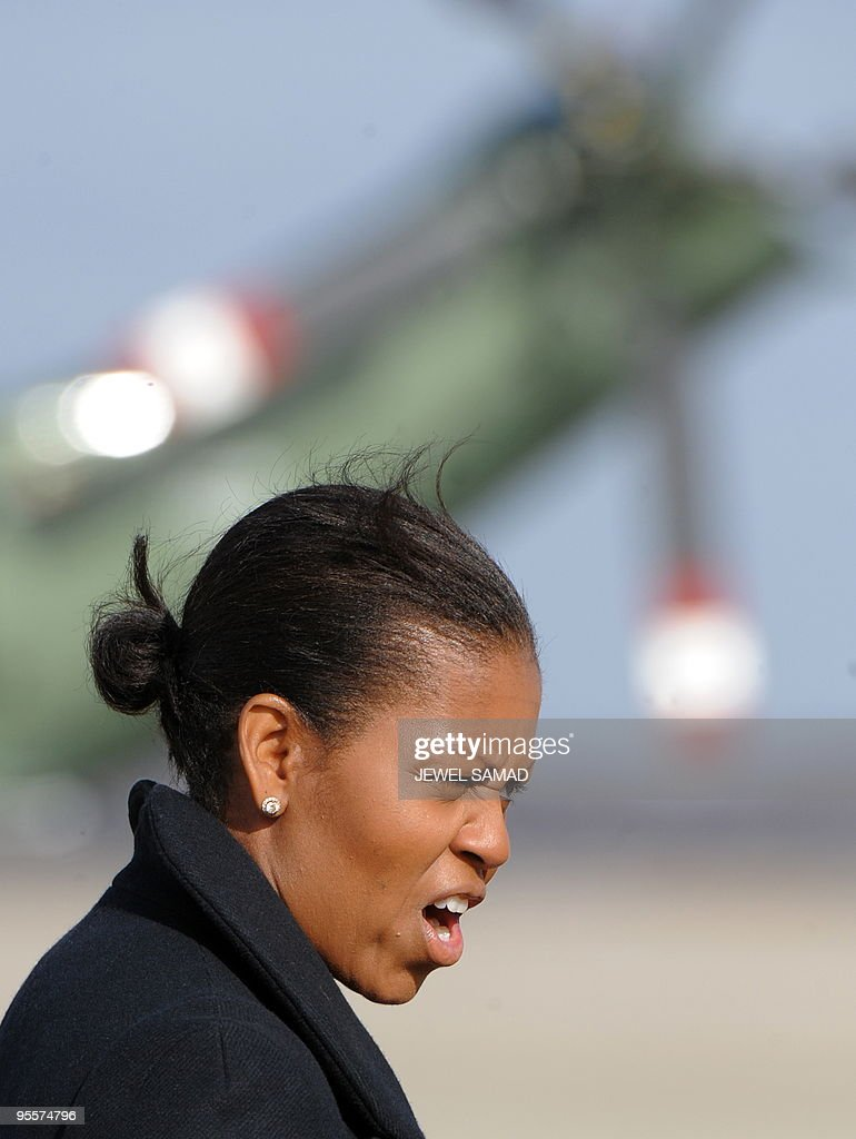 US First Lady Michelle Obama arrives at Andrews Air Force Base in Maryland on January 4, 2010 upon her return with family from vacation in Hawaii. AFP PHOTO/Jewel SAMAD